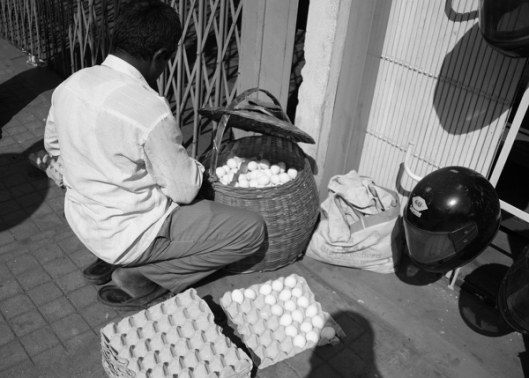 An egg vendor prepares for the day